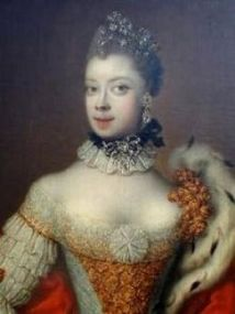 This is the negro Queen of England who reigned during the time of the enslavement of the Catholic Acadians that occurred during the expulsions of the settlers in the 1750's. It is a logical and historical fact the Jewish slave merchants required the cooperation of negro slavers for delivery of captives. Her parentage is not published anyplace that I could find.
