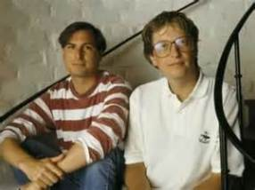 Karl Rosenberg as Steve Jobs, with Bill Gates.
